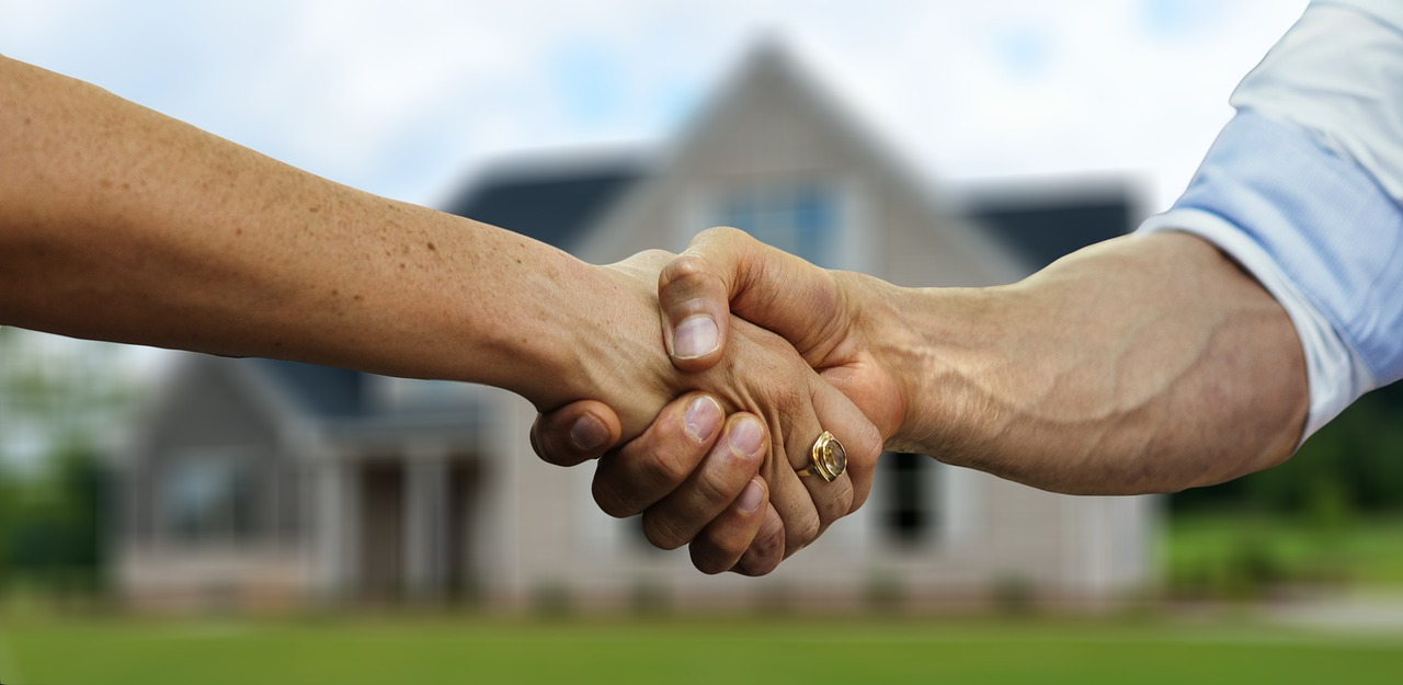 Handshake on home deal