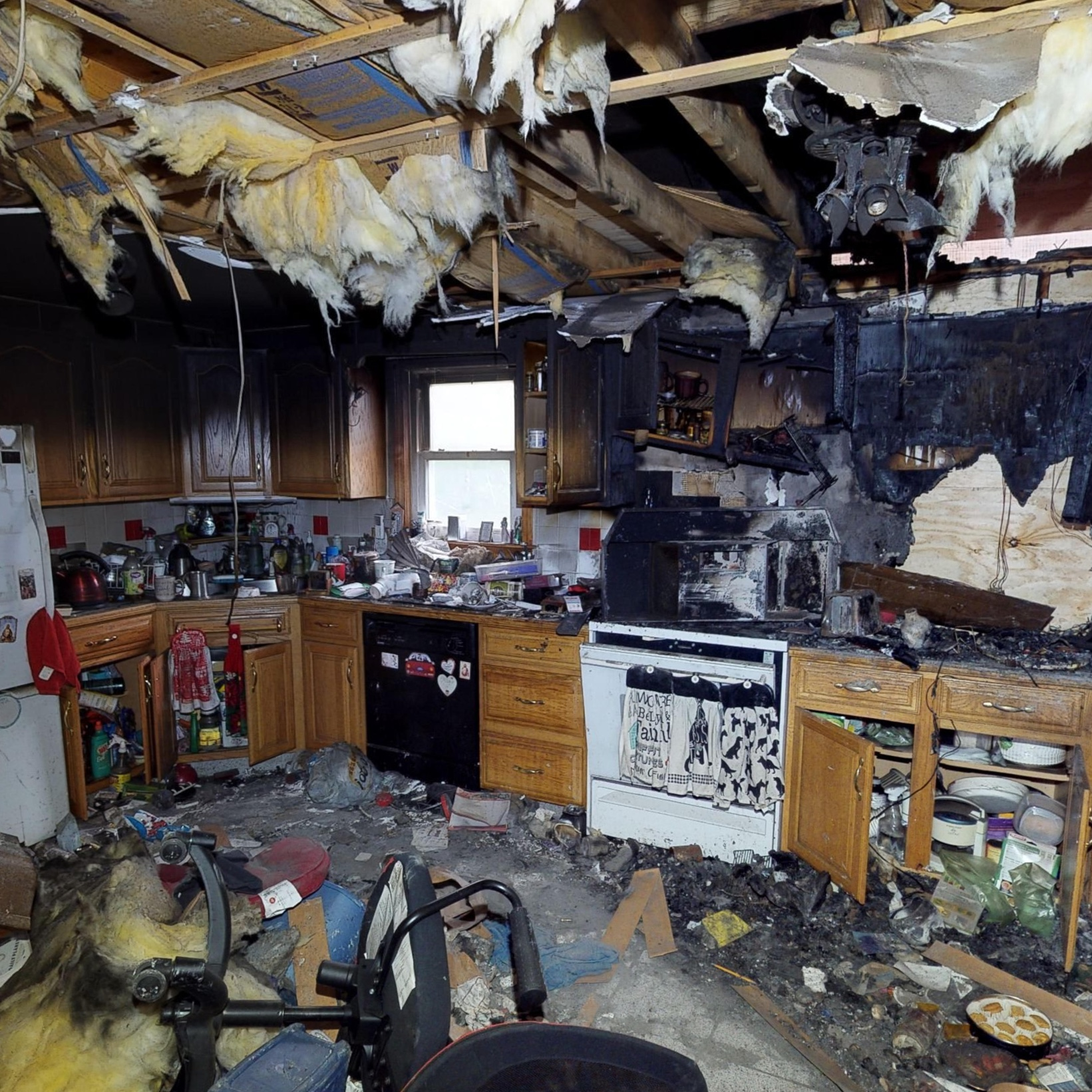 Extreme floor to ceiling property damage fills a residential kitchen