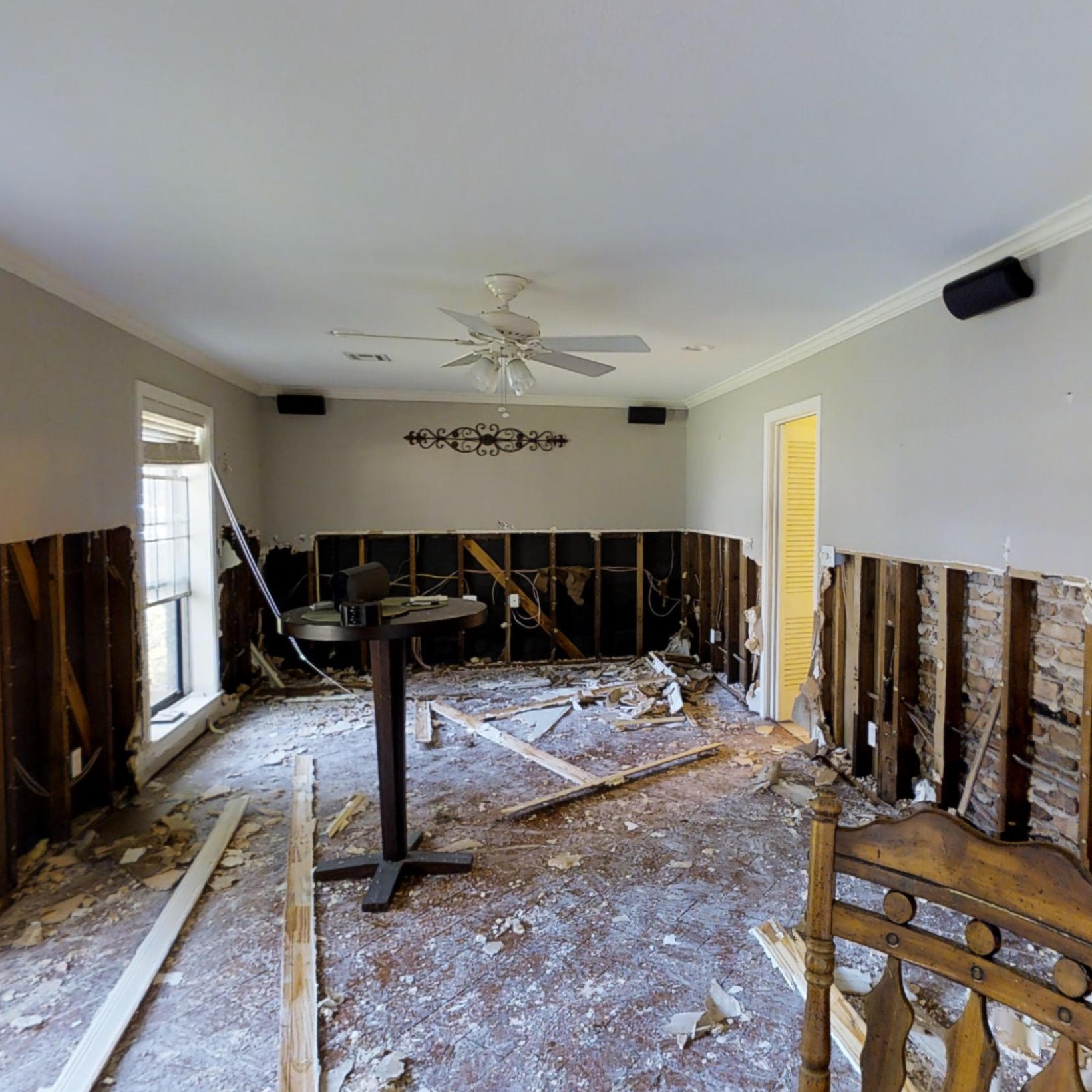Wood planks and debris littered across a living room floor